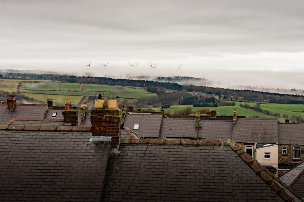 consett studio view over roof tops at wind turbines in the mist