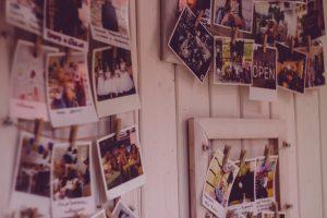 printed family photo history on wall
