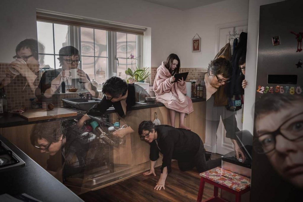 durham photographer wins contest image of photographer in many different places in a kitchen with daughter sat in the middle behind the scenes